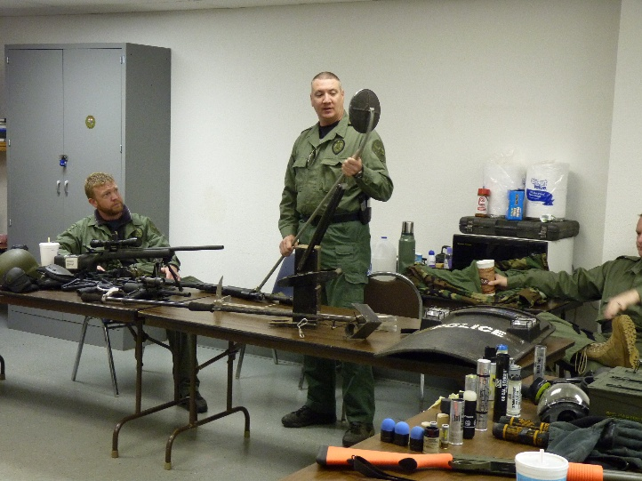 Officer Showing Weapons