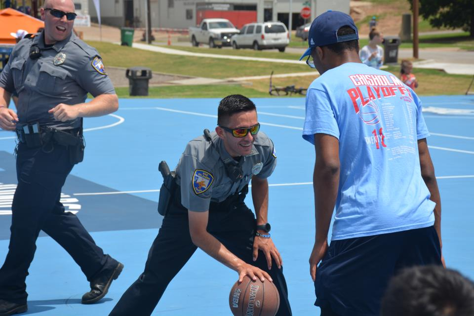 Don Haskins Court police officer playing basketball